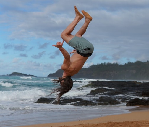 man doing a backflip in Maui Hawaii