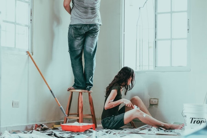 a couple doing home improvements