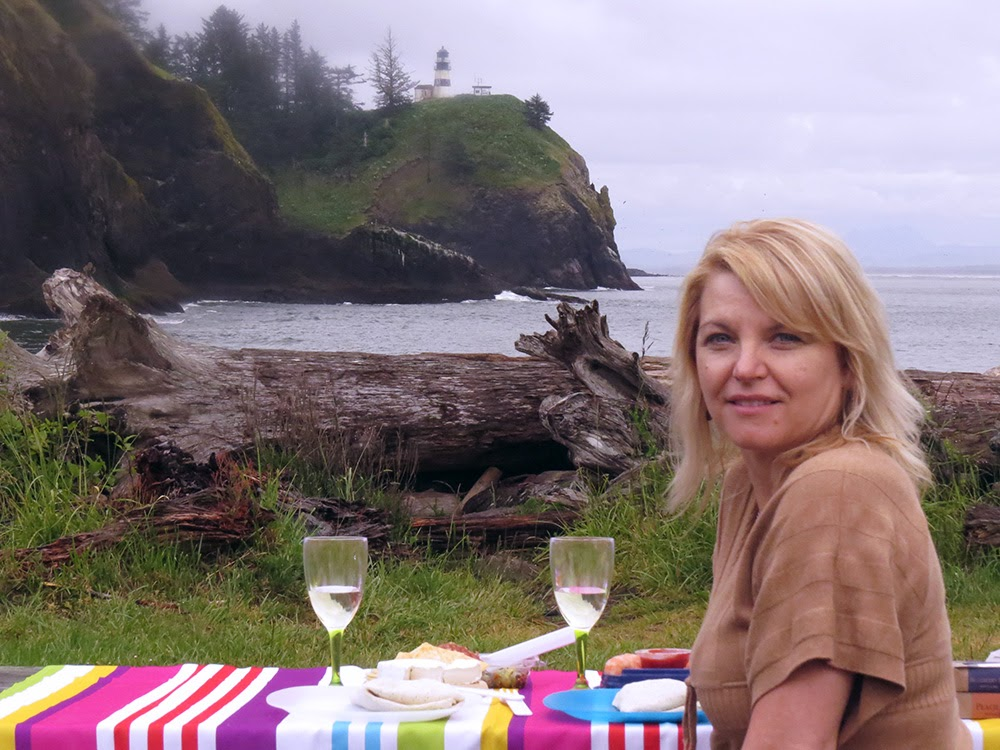 Darcy Waits a Woman sitting on a picnic blanket at Cape Disappointment