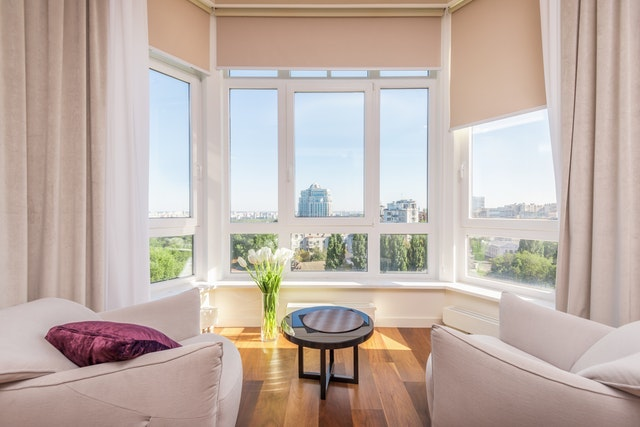 A bright room with big windows and a beautiful city view.