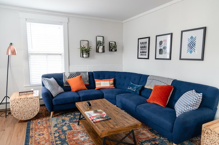 a home desin strting with a blue sofa and pillows