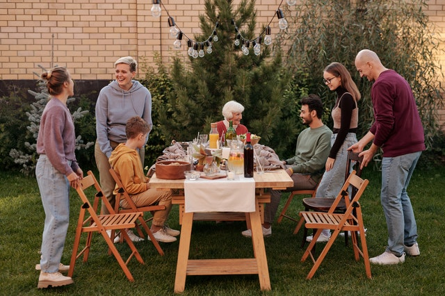 Family reunited for dinner in the backyard of a home as the best way to make your new place feel like home.