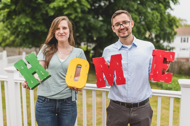 Couple holding letters that form the word home. trying to make your new place feel like home