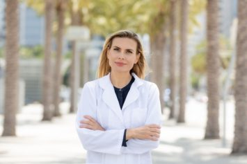Women in lab coat Lidia Domagalska LAc