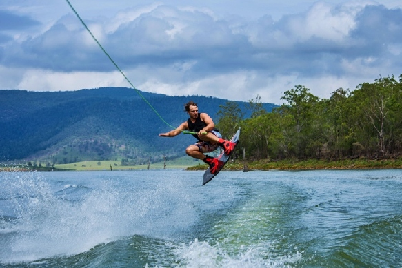 a wakeboarder wearing a wakeboarding life vest