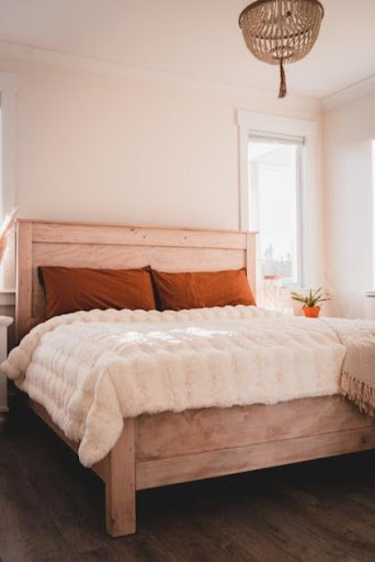 A tall bed with a lot of space underneath that can be used for storage.