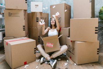 a women surrounded by moving boxes