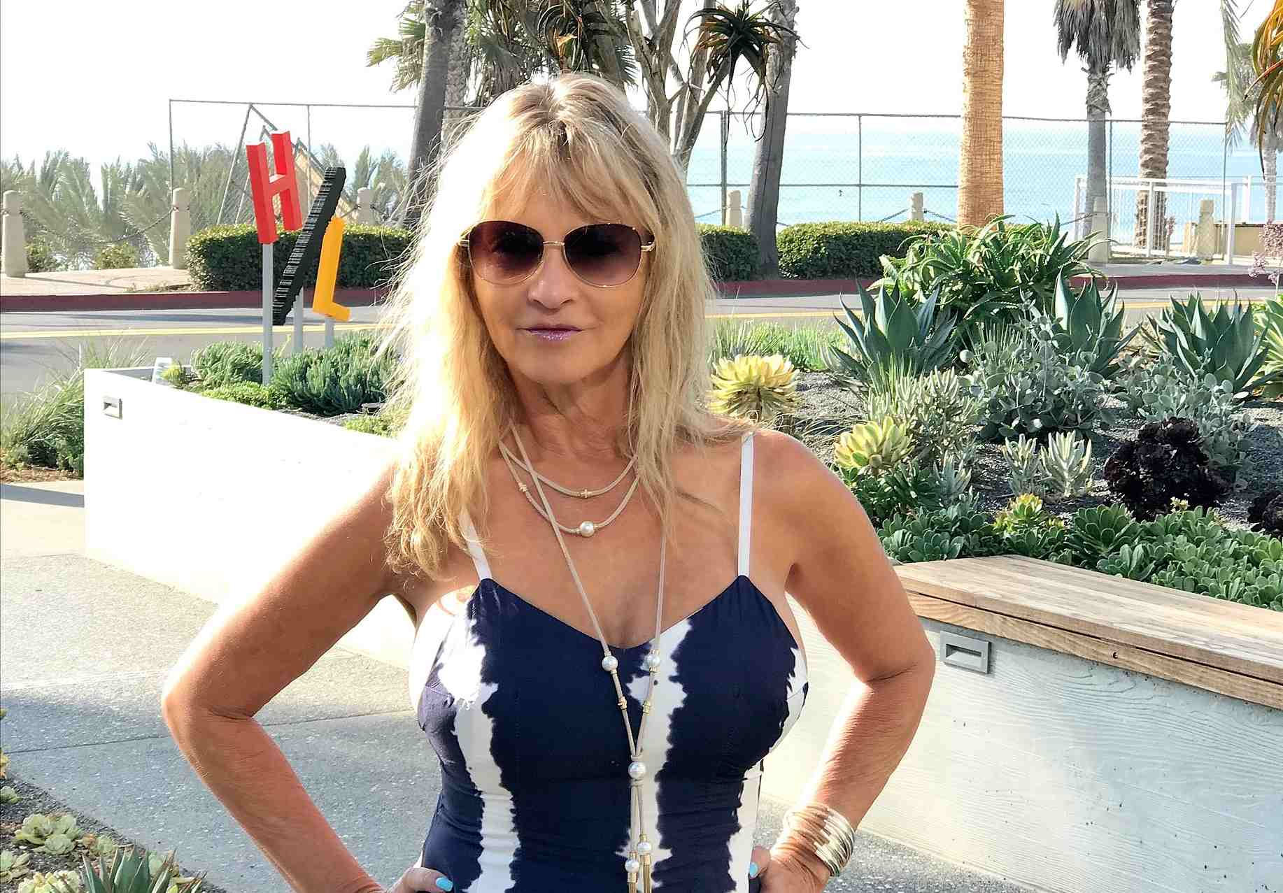 Super hot women wearing a navy blue and white maxi dress Heather Winfield