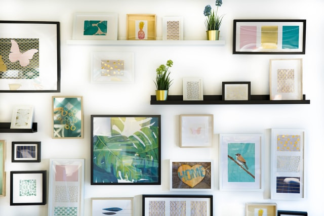 a dining room wall with wall photos and decore on it
