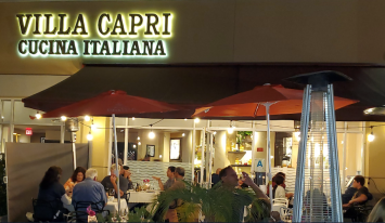 Villa Capri's Front View with a woman standing in front